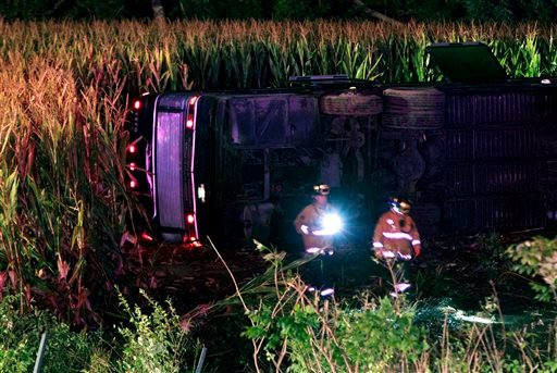 Officials work the scene of an overturned Greyhound bus on interstate I-75 in Liberty Township, Ohio on Saturday, Sept. 14, 2013. Authorities say that at least 34 people have been hurt, with injuries ranging from minor to severe.