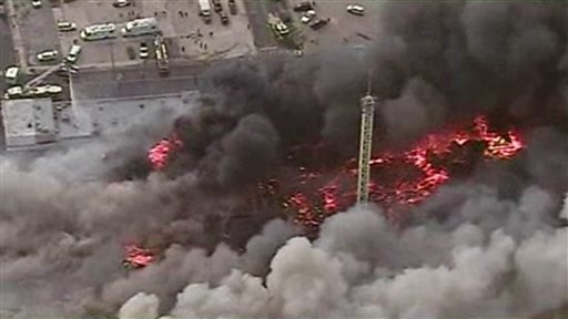This image from aerial video shows a raging fire in Seaside Park, N.J. on Thursday, Sept. 12, 2013. The fire began in a frozen custard stand on the Seaside Park section of the boardwalk and quickly spread north into neighboring Seaside Heights.