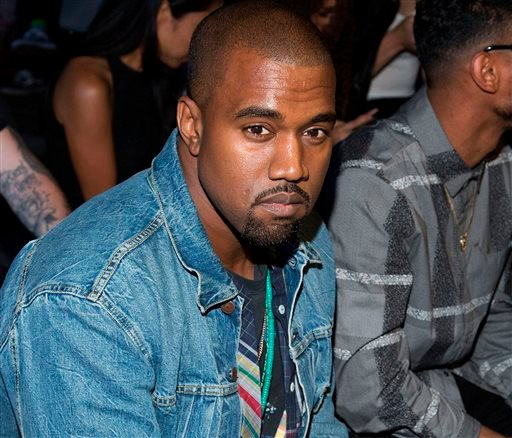 In this Saturday, Sept. 7, 2013 file photo, Kanye West attends the Alexander Wang collection, during Mercedes-Benz Fashion Week, in New York.