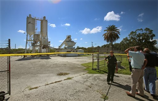 This Sept. 10, 2013, photo shows Polk County Sheriff personnel investigating the death of 12-year-old girl, Rebecca Ann Sedwick, at an old cement plant in Lakeland, Fla.