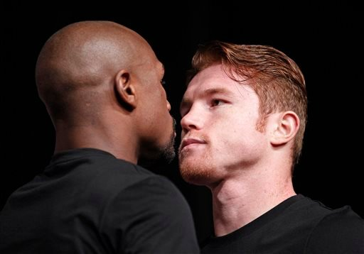 Boxers Floyd Mayweather, left, and Canelo Alvarez pose during a press conference in Las Vegas, Wednesday, Sept. 11, 2013.