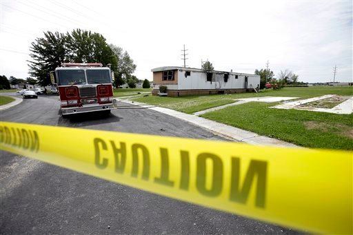 A fire swept through a mobile home Sunday, Sept. 15, 2013, killing a man and five children in Tiffin, Ohio, according to police.