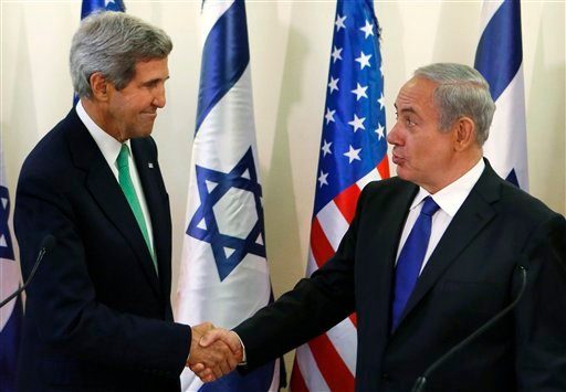 U.S. Secretary of State John Kerry, left, shakes hands with Israel's Prime Minister Benjamin Netanyahu after speaking to the media at the prime minister's office in Jerusalem, Israel, Sunday, Sept. 15, 2013.