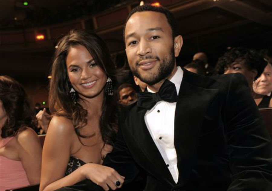 This Feb. 26, 2010 file photo shows John Legend, right, and Christine Teigen at the 41st NAACP Image Awards in Los Angeles.