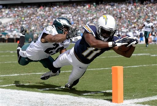 San Diego Chargers' Eddie Royal, right, dives for a touchdown as Philadelphia Eagles' Nate Allen defends during the first half of an NFL football game on Sunday, Sept. 15, 2013, in Philadelphia. (AP Photo/Michael Perez)