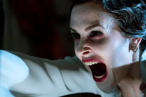 """This film image released by FilmDistrict shows Danielle Bisutti in a scene from """"Insidious: Chapter 2."""" (AP Photo/FilmDistrict, Matt Kennedy)"""