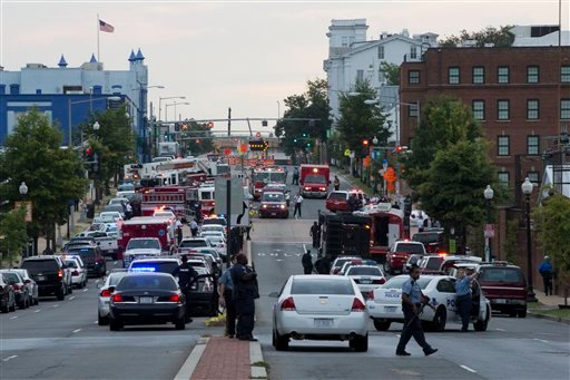 Police work the scene on M Street, SE in Washington, where a gunman was reported at the Washington Navy Yard in Washington, on Monday, Sept. 16, 2013.