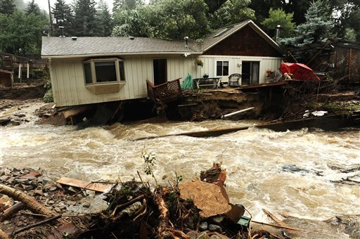 What looks like a river in fact used to be the front and back yards of the residents of these homes in Jamestown, Colo., on Sunday Sept. 15, 2013.