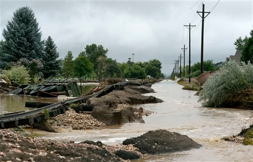 A truck rests next to the washed out railroad track in the Champion Greens neighborhood in Longmont, Colo., Sunday Sept. 15, 2013.
