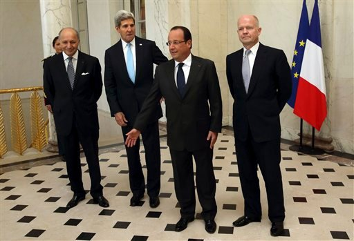 From left, French Foreign Minister Laurent Fabius, U.S. Secretary of State John Kerry, French President Francois Hollande and British Foreign Secretary William Hague, pose in the lobby of the Elysee Palace in Paris, prior to a meeting on Syria, Monday.