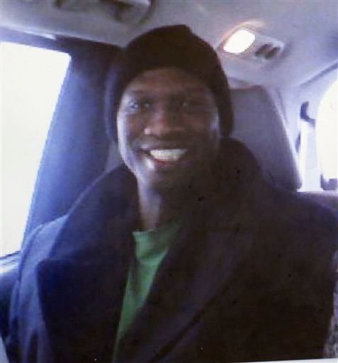 This undated cell phone photo provided by Kristi Kinard Suthamtewakul shows a smiling Aaron Alexis in Fort Worth, Texas. (AP Photo/Kristi Kinard Suthamtewakul)