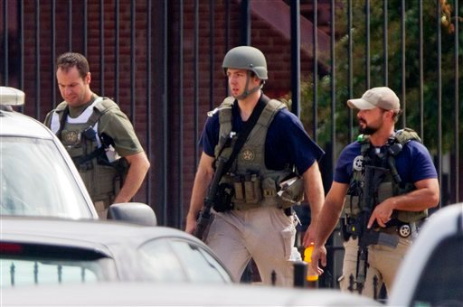 Armed U.S. Marshals leave the scene where a gunman was reported at the Washington Navy Yard in Washington, on Monday, Sept. 16, 2013.