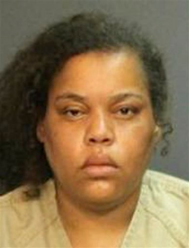 This image provided by the Santa Ana Police Department shows Marilyn Edge, 42, of Scottsdale, Ariz., who was arrested Sept. 14, 2013, and booked on suspicion of murder in the deaths of two children.