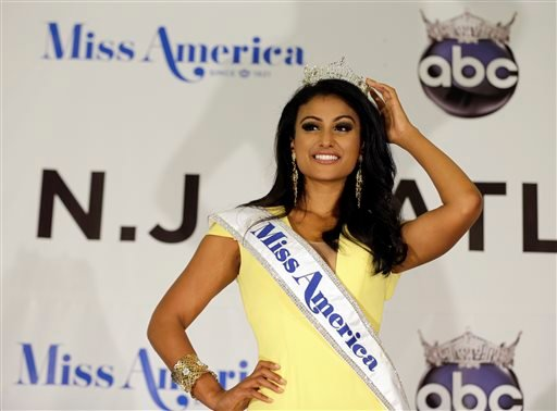 In this Sunday, Sept. 15, 2013 file photo, Miss America Nina Davuluri poses for photographers following her crowning in Atlantic City, N.J.