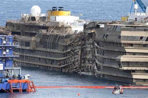The Costa Concordia is seen after it was lifted upright, on the Tuscan Island of Giglio, Italy, Tuesday, Sept. 17, 2013. (AP)
