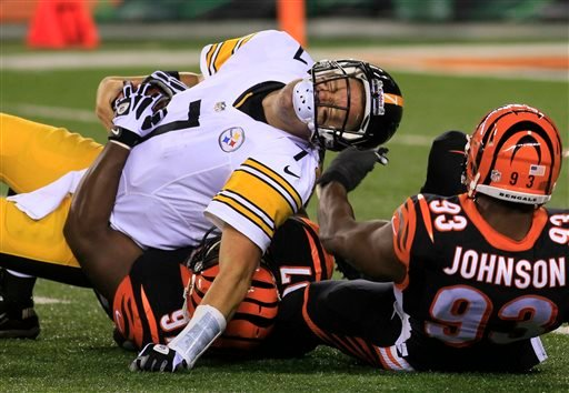 Pittsburgh Steelers quarterback Ben Roethlisberger (7) is sacked by Cincinnati Bengals defensive tackle Geno Atkins (97) and defensive end Michael Johnson (93) in the second half of an NFL football game, Monday, Sept. 16, 2013, in Cincinnati.