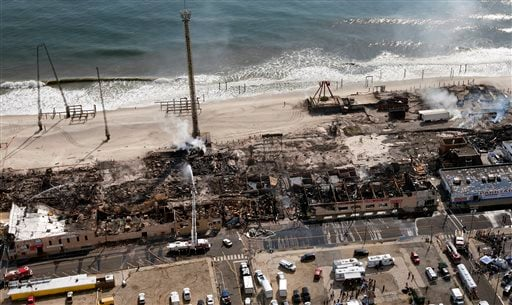 This aerial photo shows aftermath of a massive fire that burned a large portion of the Seaside Park boardwalk, Friday, Sept. 13, 2013, in Seaside Park, N.J.