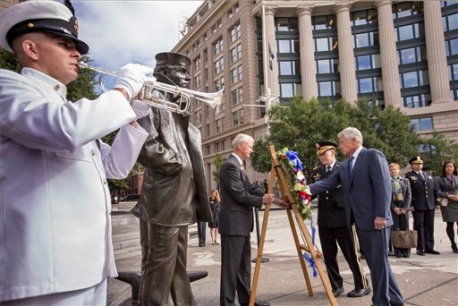 Defense Secretary Chuck Hagel, right, and Joint Chiefs Chairman Gen. Martin Dempsey, second from right, present a wreath at the Navy Memorial in Washington to remember the victims of Monday's deadly shooting at the Washington Navy Yard, Sept. 17, 2013.
