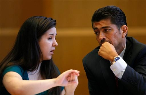 Jennifer Mee talks with her attorney Bryant Camareno, as jury selection begins her murder trial, Tuesday, Sept. 17, 2013, at the Pinellas County Justice Center in Clearwater, Fla. (AP)