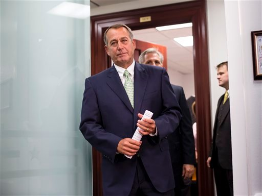 Speaker of the House John Boehner, R-Ohio, and House Republican leaders emerge from a closed-door strategy session at the Capitol, Wednesday, Sept. 18, 2013. (AP)
