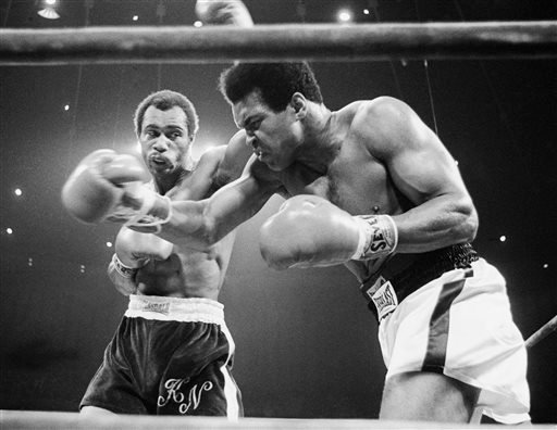 FILE - In this Sept. 10, 1973, file photo, Muhammad Ali, right, winces as Ken Norton hits him with a left to the head during their re-match at the Forum in Inglewood, Calif. (AP)
