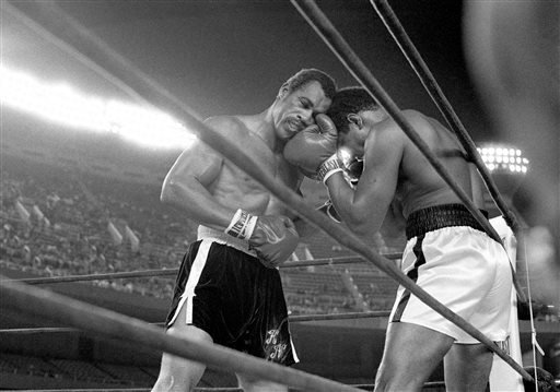 FILE - In this Sept. 28, 1976, file photo, challenger Ken Norton, left, and heavyweight champion Muhammad Ali trade right punches in the late rounds of their title fight in New York's Yankee Stadium. (AP)