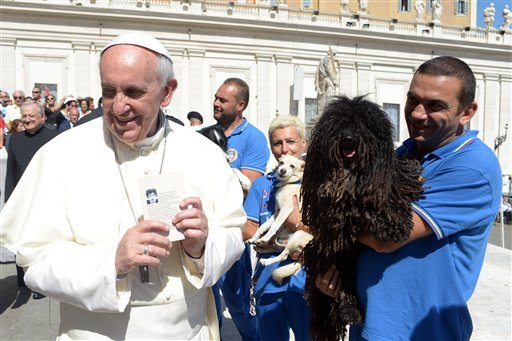 Pope Francis is shown a dog by a member of the Federazione Italiana Sport Cinofili (Italian Federation of Canine' Sports), following his weekly general audience at the Vatican, Wednesday, Sept. 18, 2013. (AP Photo/L'Osservatore Romano, ho)