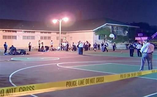 This still frame made from Thursday, Sept. 19, 2013, video provided by Ken Herzlich, shows the scene where a number of people, including a 3-year-old child, were shot Thursday night in a city park in Chicago. (AP)