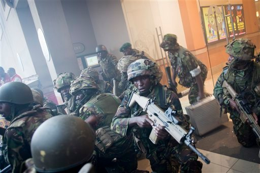 Armed police leave after entering the Westgate Mall in Nairobi, Kenya Saturday, Sept. 21, 2013.
