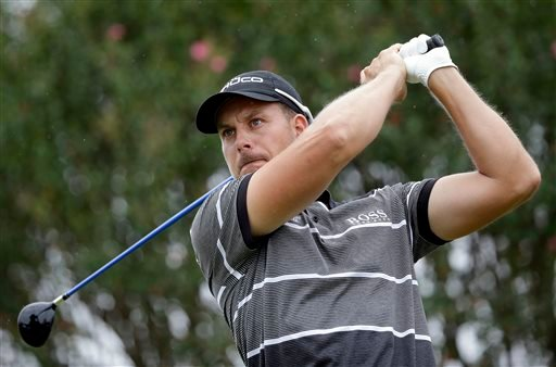 Henrik Stenson, of Sweden, tees off the seventh hole during the third round of play in the Tour Championship golf tournament at East Lake Golf Club, in Atlanta, Saturday, Sept. 21, 2013. (AP Photo/David Goldman)
