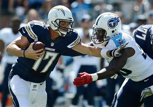San Diego Chargers quarterback Philip Rivers (17) tries to get past Tennessee Titans linebacker Akeem Ayers (56) in the second quarter of an NFL football game on Sunday, Sept. 22, 2013, in Nashville, Tenn. (AP Photo/Mark Zaleski)