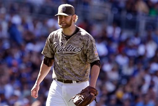 San Diego Padres starting pitcher Andrew Cashner walks off the mound yelling at himself after he allowed a run to score by the Los Angeles Dodgers in the seventh inning of a previously scoreless baseball game Sunday, Sept. 22, 2013, in San Diego.