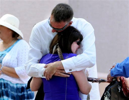 Ron Quinlan, father of Wesley, has a hug for Wesley's mother, Glenda Aretxuloeta, before the memorial service. A memorial service for Wiyanna Nelson and Wesley Quinlan was held at NCAR in Boulder, Colo., on Saturday, Sept. 21, 2013.