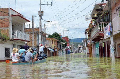 Villagers are evacuated from flooded areas in the town of Tixtla de Guerrero, Mexico, Sunday, Sept. 22, 2013.