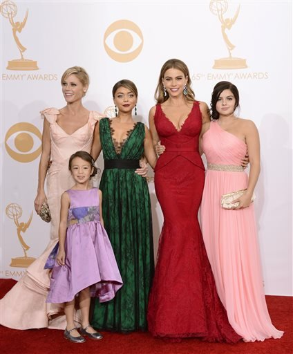 """Julie Bowen, from left, Aubrey Anderson-Emmons, Sarah Hyland, Sofia Vergara and Ariel Winter, winners of outstanding comedy series for """"Modern Family,"""" pose backstage at the 65th Primetime Emmy Awards at Nokia Theatre on Sunday Sept. 22, 2013."""