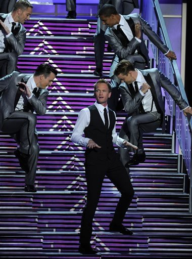 Neil Patrick Harris performs on stage at the 65th Primetime Emmy Awards at Nokia Theatre on Sunday Sept. 22, 2013, in Los Angeles. (Photo by Chris Pizzello/Invision/AP)