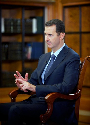 In this photo released by the Syrian official news agency SANA, Syrian President Bashar Assad speaks during an interview with Chinese state CCTV, in Damascus, Syria, Monday, Sept. 23, 2013.