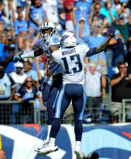 Tennessee Titans wide receiver Justin Hunter, left, celebrates with Kendall Wright (13) after Hunter caught the game-winning touchdown pass on a 34-yard pass play against the San Diego Chargers in the fourth quarter of an NFL football game on Sunday.
