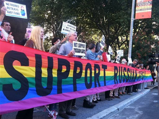 In this photo provided by Queer Nation NY, anti-Putin protestors demonstrate outside the Metropolitan Opera at Lincoln Center, Monday, Sept. 23, 2013, in New York.