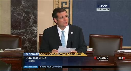 In an image made from the C-Span broadcast Senator Ted Cruz continues to speak on the floor of the U.S. Senate at 5:21 a.m. EDT Wednesday Sept. 25, 2013. (AP Photo/CSPAN)