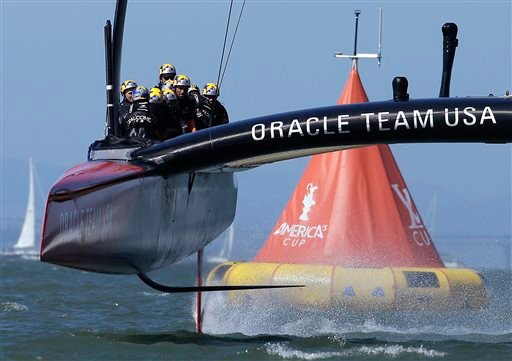 Oracle Team USA crosses the finish line during the 18th race of the America's Cup sailing event against Emirates Team New Zealand on Tuesday, Sept. 24, 2013, in San Francisco.