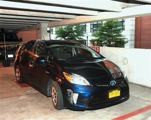 This image from video provided by the FBI, shows Aaron Alexis' rental car, a blue Toyota Prius with New York license plates parked in Parking Garage #28 at the Washington Navy Yard on Monday, Sept. 16, 2013, in Washington. (AP)
