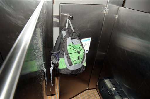 This image from video provided by the FBI, shows Aaron Alexis' backpack that was found hanging on the back of a bathroom stall door in the fourth-floor men's bathroom in building #197 at the Washington Navy Yard on Monday, Sept. 16, 2013, in Washington.