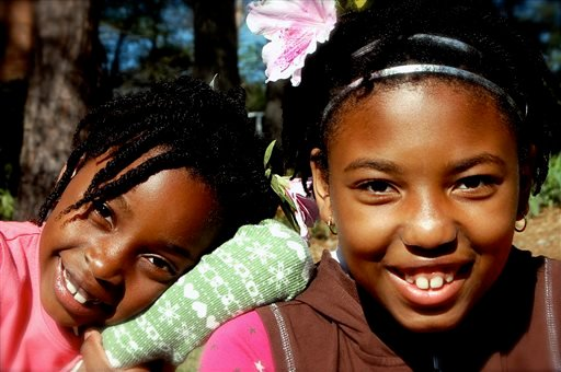 This 2009 photo released by author and blogger Denene Millner shows her daughters, Lila Chiles, 7, left, and Mari Chiles in Snellville, Ga. (AP)