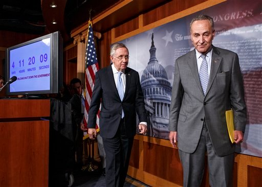 Senate Majority Leader Harry Reid of Nev., left, follows Sen. Charles Schumer, D-N.Y., right, the Democratic Policy Committee chairman, after a news conference on Capitol Hill Sept. 26, 2013. (AP Photo/J. Scott Applewhite)