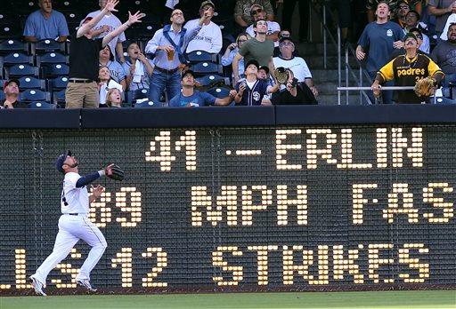 San Diego Padres left fielder Mark Kotsay watches as Arizona Diamondbacks' Martin Prado's two-run home run clears the left field wall during the fourth inning of a baseball game Sept. 26, 2013, in San Diego. San Diego won 3-2.(AP Photo/Don Boomer)