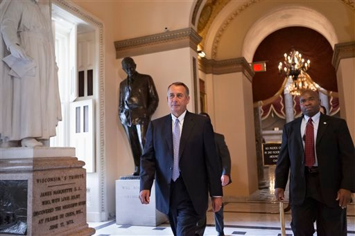 House Speaker John Boehner of Ohio walks to the floor of the House on Capitol Hill in Washington, Friday, Sept. 27, 2013, as Congress continues to struggle over how to fund the government and prevent a possible shutdown. (AP Photo/J. Scott Applewhite)