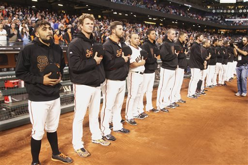 San Francisco Giants observe a moment of silence before a baseball game aganist the Los Angeles Dodgers, Thursday, Sept. 26, 2013, in San Francisco. (AP Photo/George Nikitin)