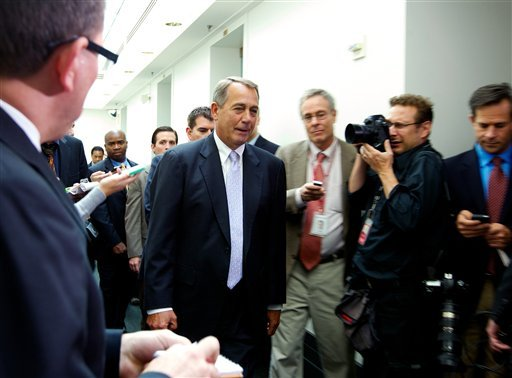 House Speaker John Boehner of Ohio, walks out of a Republican caucus at the U.S. Capitol in Washington, Saturday, Sept. 28, 2013. (AP Photo/Molly Riley)