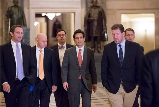 House Majority Leader Eric Cantor, R-Va., center, walks to the floor of the House for the final series of votes on a bill to fund the government, in Washington, Saturday, Sept. 28, 2013. (AP Photo/J. Scott Applewhite)